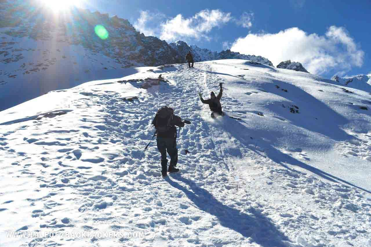 Sliding down on the snow from Junargali