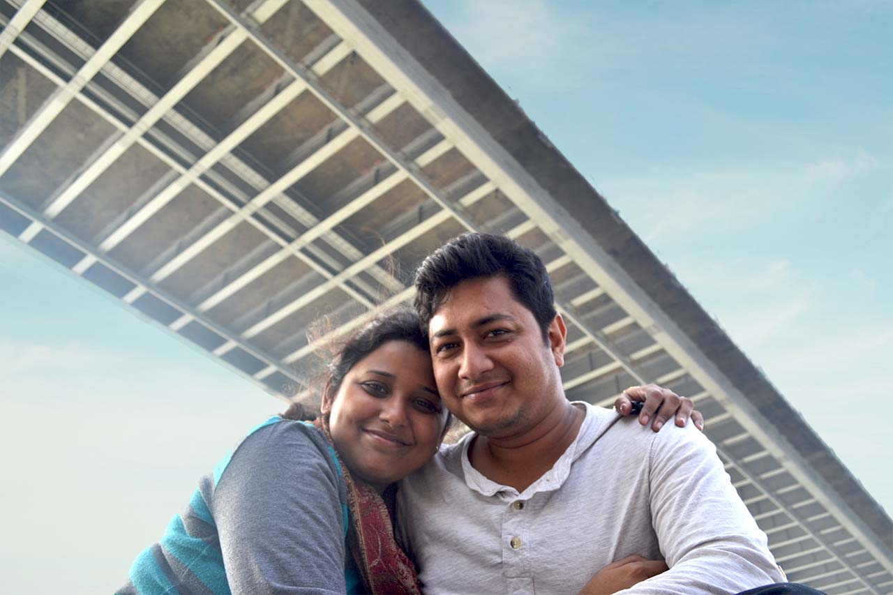2 Backpackers taking a boat ride on Hooghly River at Princep Ghat
