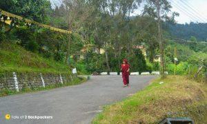 A monk walking on the roads of Gangtok