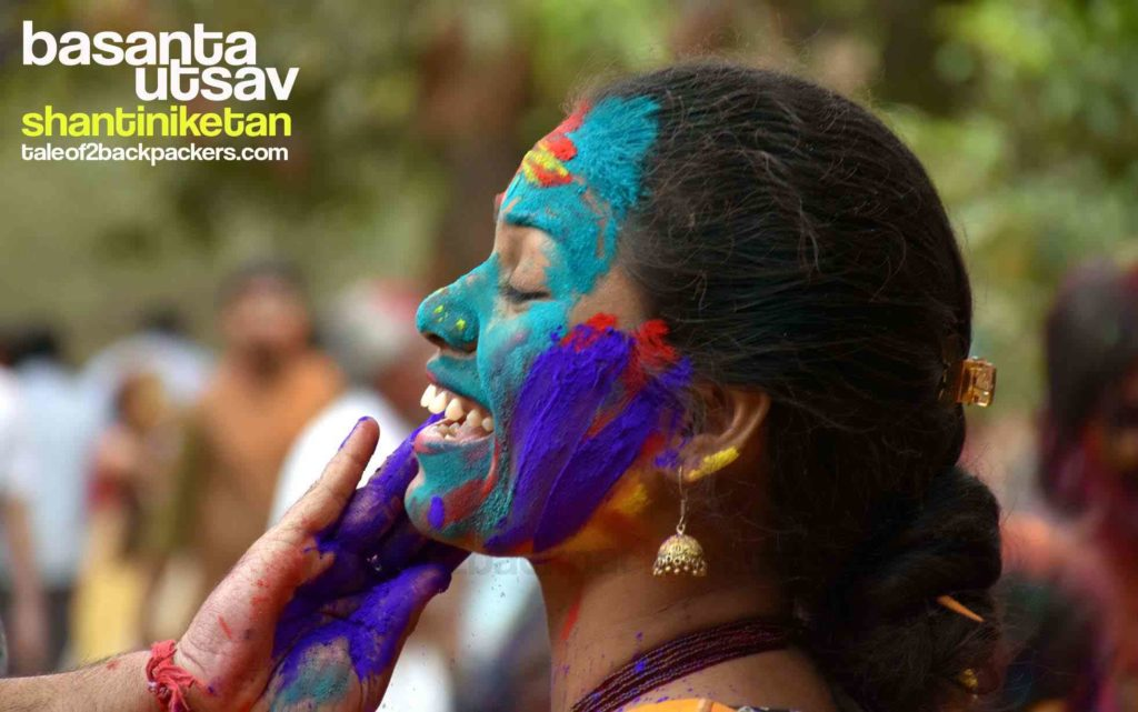 Smearing the face with Abir or dry colours - Holi in Shantiniketan is safe