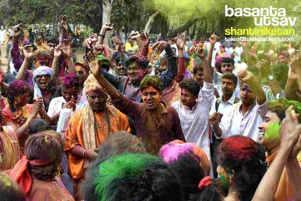 People playing with colours during Holi in Shantiniketan