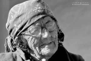 An old woman with a wrinkled face - Adventure Bucket List