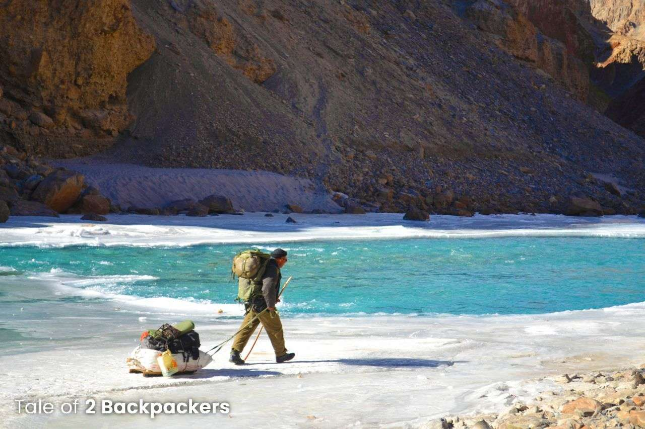 Person carrying goods on a sledge at Chadar Trek