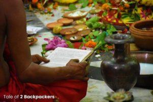 Priest chanting prayers during Durga Puja