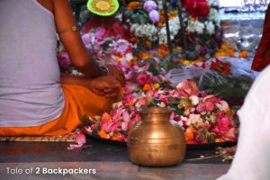 Priest offering prayers during Puja