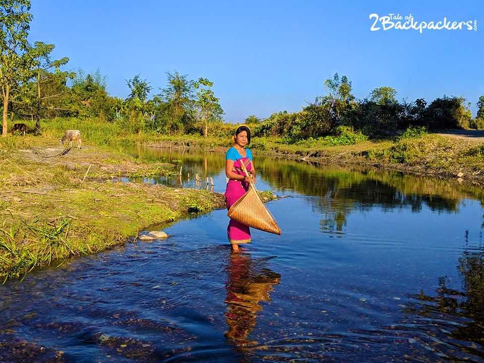 A woman of Bodoland fishing - Assam Tourism