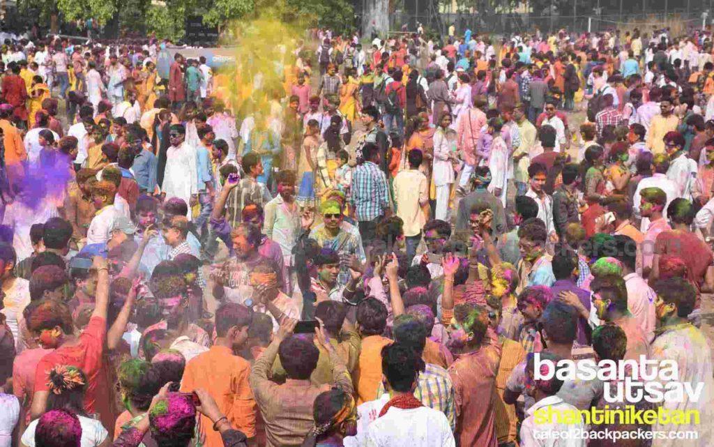 People playing with colours during Basanta Utsab at Shantiniketan