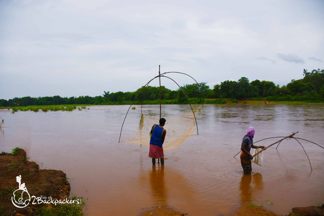 Fishermen fishing at Buribalam river in Bangriposi - offbeat weekend destinations from Kolkata