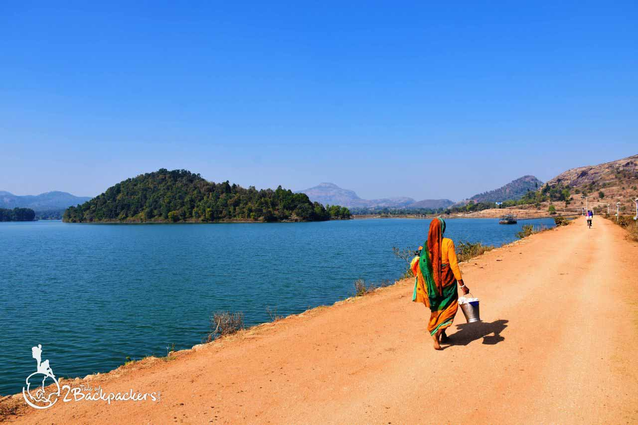 A woman walking on the Muruguma dam near the Muruguma Lake in Purulia