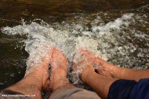 soaking leg in the river