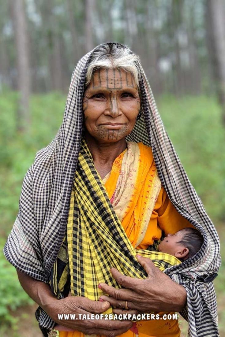 tribal lady with a child at pine forest in Daringbadi, Odisha