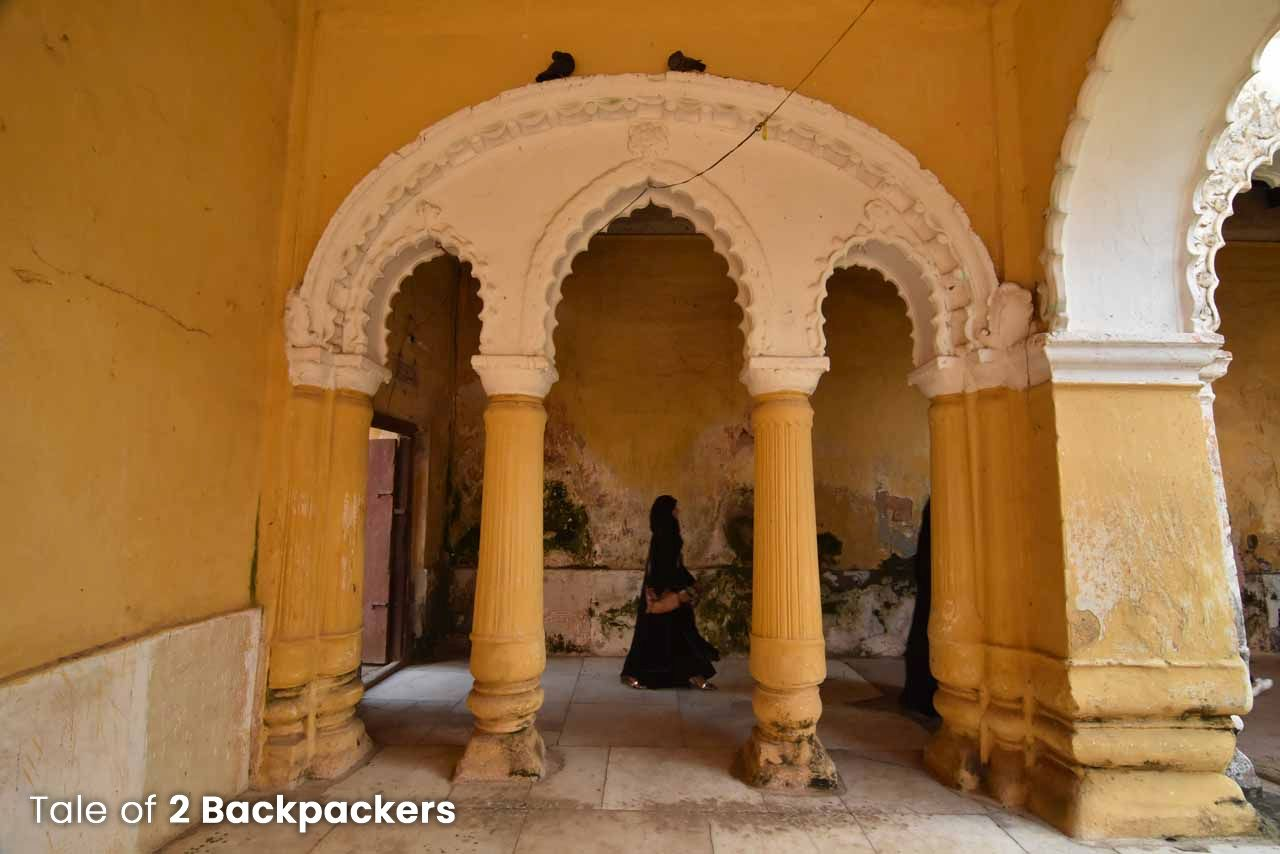 A woman walking inside the Nasipur Palace