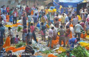 Vendors selling flowers at Mallick Ghat Flower Market, Kolkata Travel Guide
