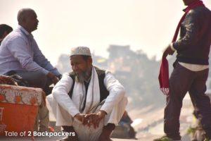 A man sitting at Varanasi Ghat