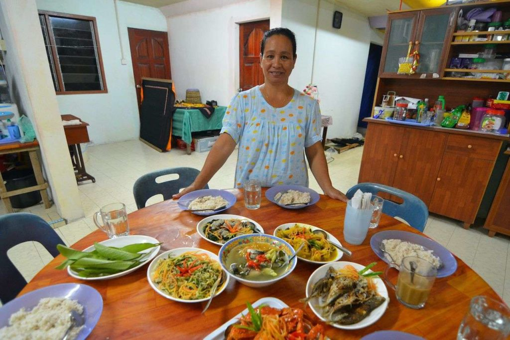 Rungus women prepares a feast for guests and extended family members - tribes of Malaysia