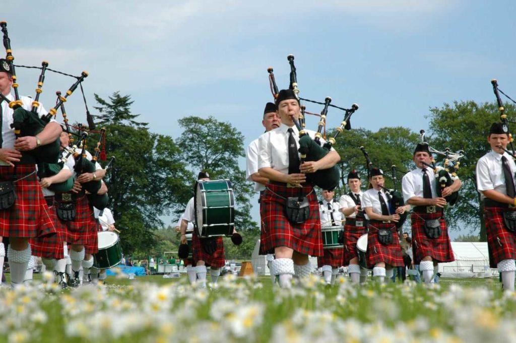 Scottish band marching on grass