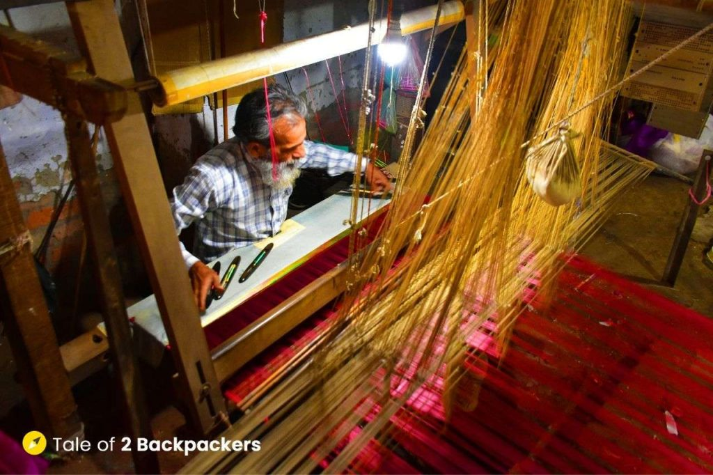 A weaver working on handloom at a factory in Madanpura, Varanasi