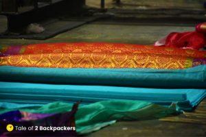 Bales of Banarasi silk lying on the floor at a Karkhaana or factory in Madanpura in Varanasi