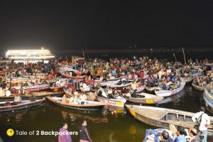 Boats in front of Dashashwamedh Ghat with people on it for watching th eVaranasi Ganga Aarti there