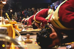 The Varanasi Ganga Aarti ends as the priests bows down their heads to pray