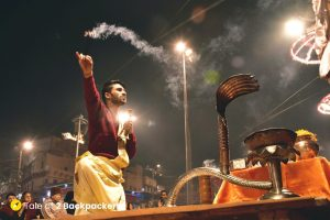 The priests hold incense sticks in one hand and prayer bells on the other during the Ganga Aarti at Varanasi