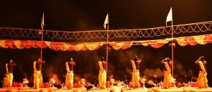 Priests performing Aarti during Subah-e-Banaras at Assi Ghat at the crack of dawn