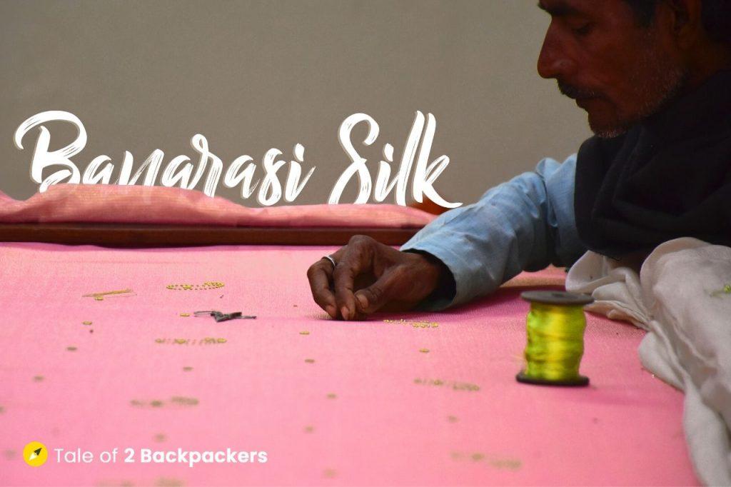 A weaver working on zardozi work on a Banarasi silk saree in Varanasi