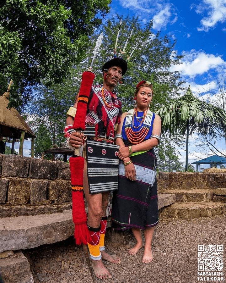 A Naga couple posing for photographs