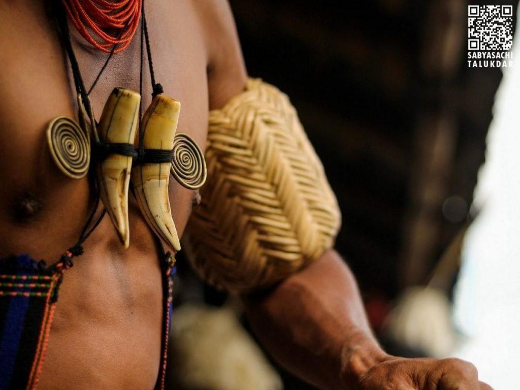 A man wearing Naga jewelery made from bones