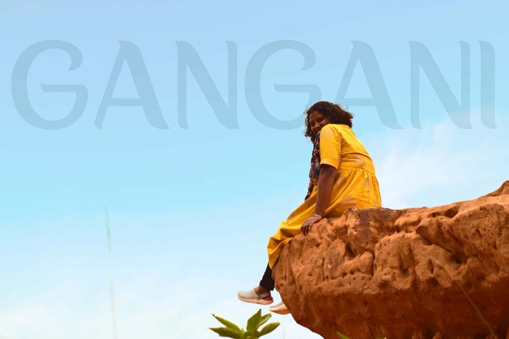 Sitting on top of a rock at Gangani
