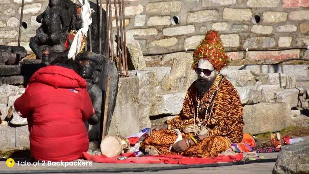 A holy man or Sadhu sitting near the Kedarnath Temple