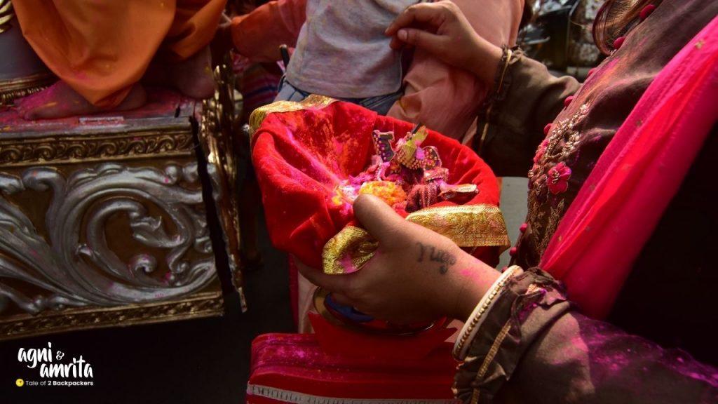 A woman carrying Satyanarayan Deity