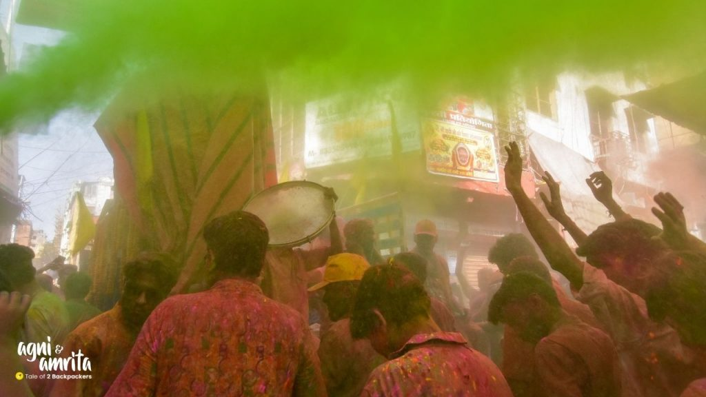 People playing drums during Holi procession in Kolkata