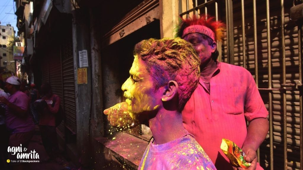 Smearing colours on the face during Holi