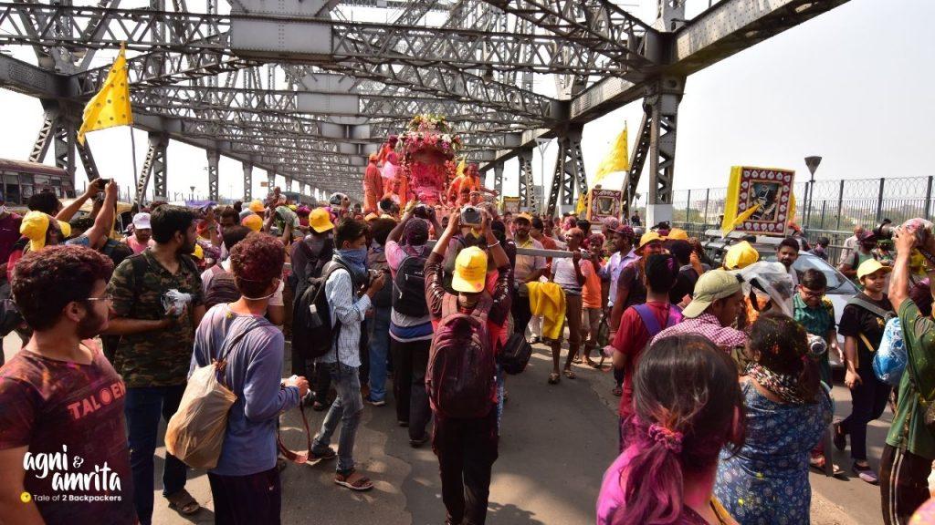 Rolls Royce Holi Procession crossing the Howrah Bridge Kolkata