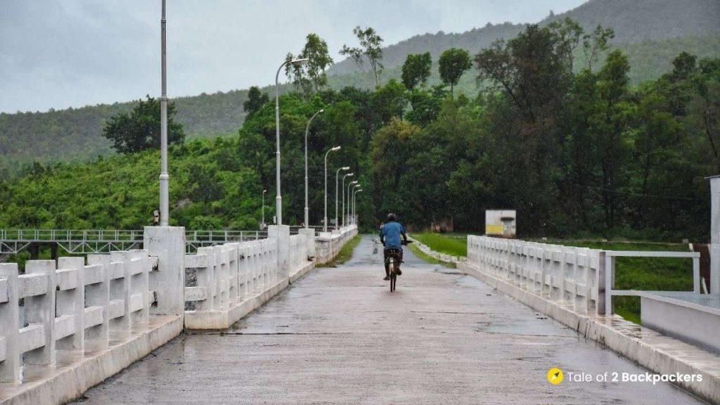 A man riding a cycle at Sulaipat Dam