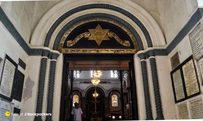Caretaker of Magen David Synagogue standing at the entrance
