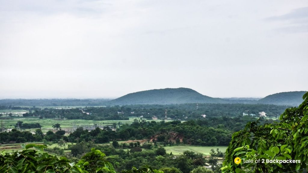 View of the mountains and fields from train towards Bangriposi