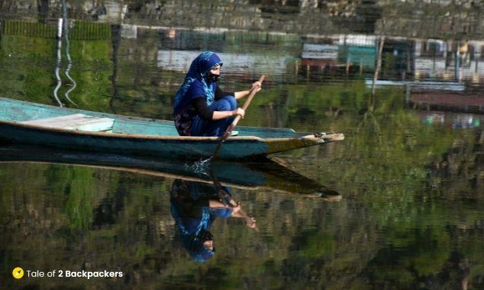 Young woman riding a Shikara at Dal Lake