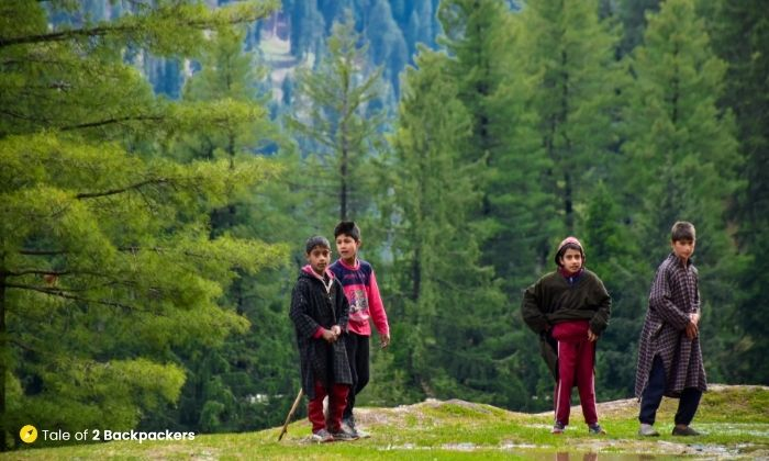 Kashmiri boys playing cricket